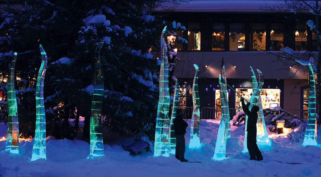 AE Verdant Meadows2 PU 1-10-08 Preston Utley/putley@vaildaily.com The finishing touches are put on a project titled Verdant Meadows  Thursday night in Vail.  Local ice sculpture Scott Rella and Denver artist Lawrence Argent collaborated on the project called Verdant Meadows wich represent Vail's alpine meadows.  Several ice sculptures are located near the Gore Creek Promenade, and resemble blades of grass.