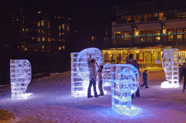 Guests wander among the pieces comprising the Triumph Winterfest ice sculpture 'are you listening' in Vail, Colorado on Friday, January 15, 2010. Copyright photo by Peter M. Fredin